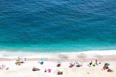 Beautiful seashore with sunbathe people