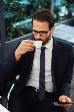 Businessman in glasses drink coffee