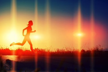 Woman running down the beautiful road