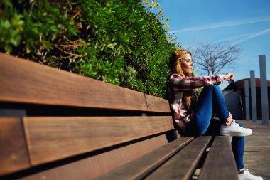 Woman on the bench enjoying nature