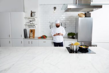 Male chef cook standing on kitchen