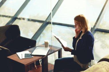 Businesswoman having cell phone conversation