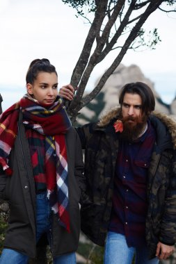 Couple of hipsters posing in nature mountains