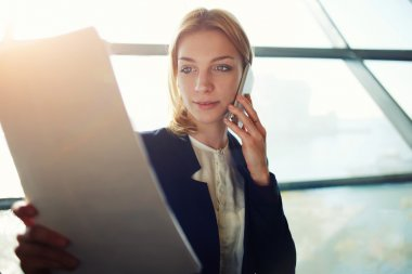 Business woman having cell phone conversation