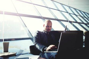 Businessman typing on computer keyboard