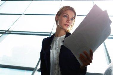 Business woman examining paperwork
