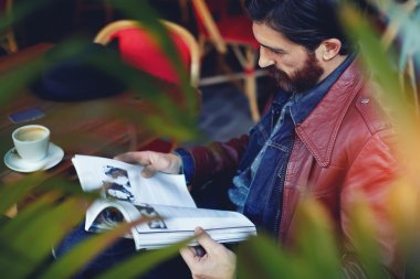 Hipster man read magazine