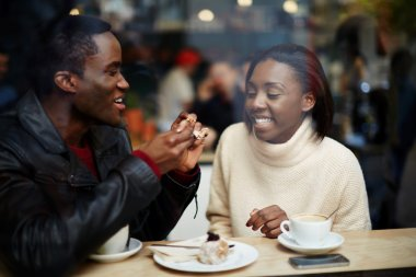 Couple in love having coffee in cafe