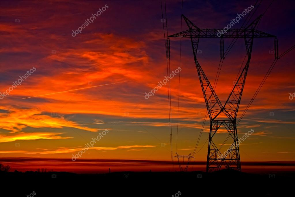 Electricity tower on dramatic colorful sky