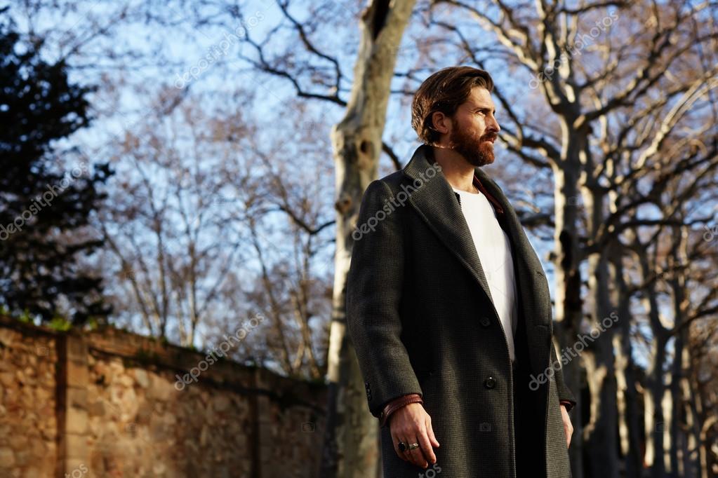 Well dressed man with beard posing