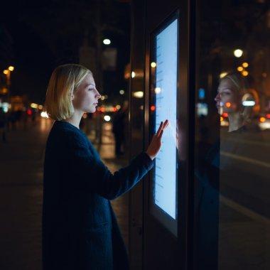 female using automated teller machine