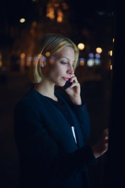 Woman speaking on smartphone