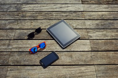 digital tablet, smart phone and sunglasses