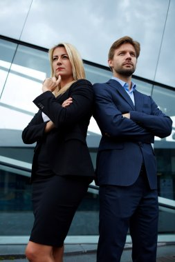 business colleagues standing near office building