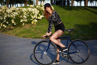 stylish hipster girl on bike