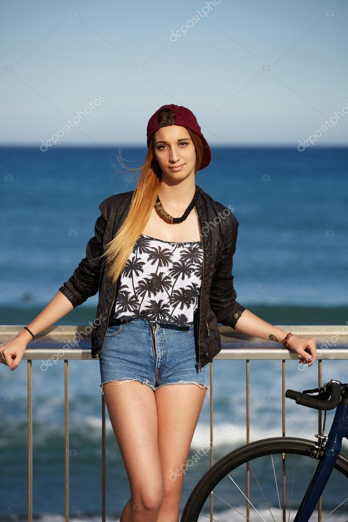 stylish hipster girl standing on the pier