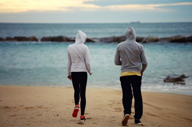 runners walking on the beach