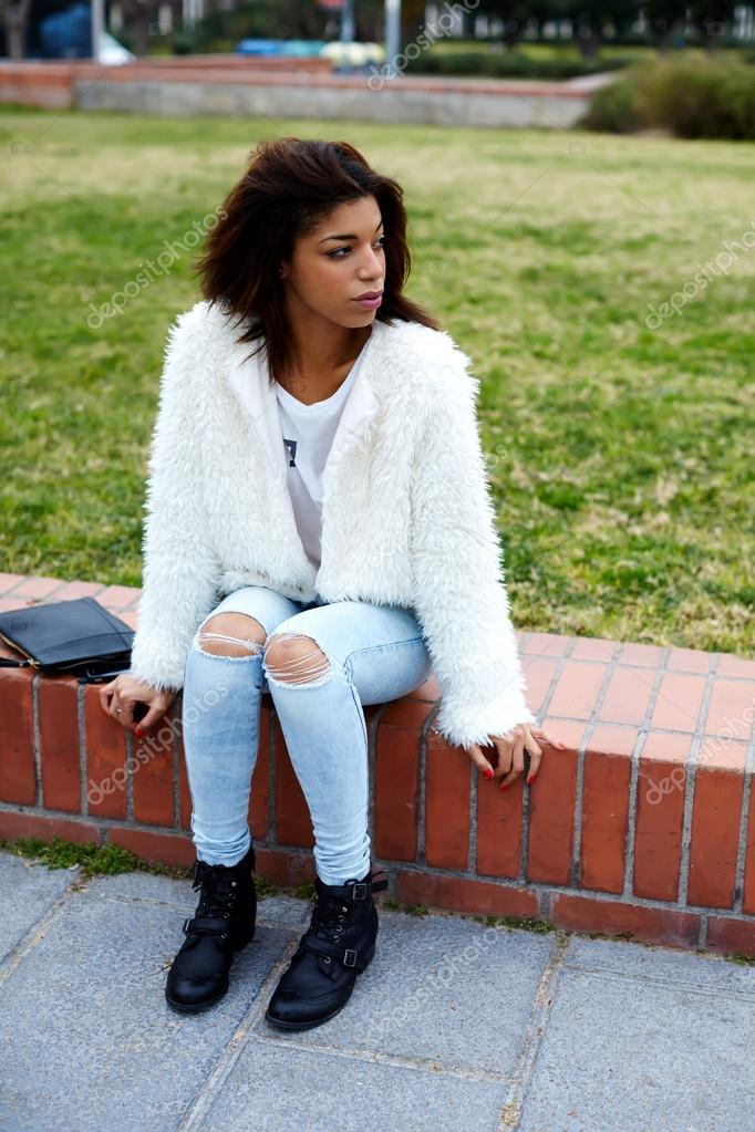 woman hipster in stylish clothing posing