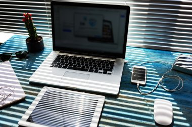 Modern freelance desktop with accessories and distance work tools