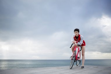 female cyclist leaning on her bicycle