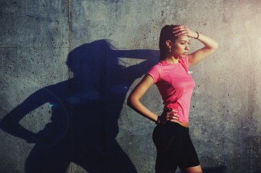 Woman jogger in bright sportswear