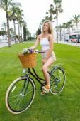 Hipster girl enjoying bike strolling