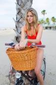 Seductive woman sitting on retro bike