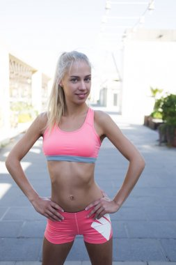 Young fitness woman relaxing after a workout