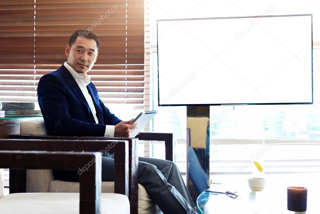 Asian businessman working on touch pad