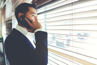 Asian businessman talking on mobile phone