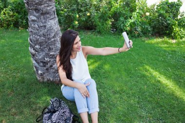 Girl making self portrait with her smartphone