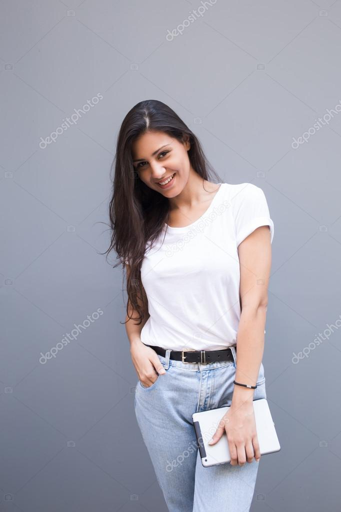 Charming woman holding digital tablet