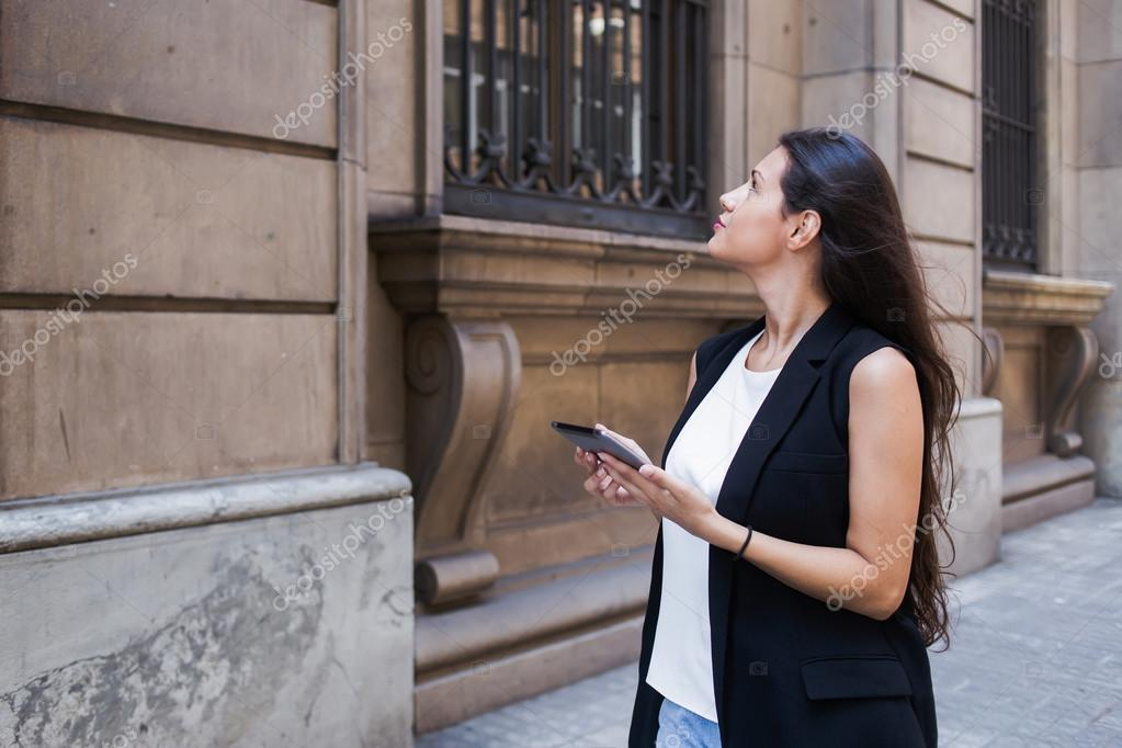 Woman with digital tablet in urban setting