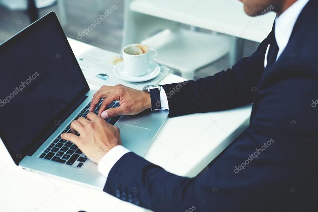 Successful businessman working on his laptop