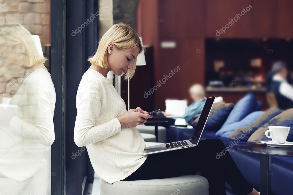 Young businesswoman working on smartphone