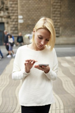 Woman using smartphone in urban setting