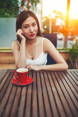 Attractive woman sitting in modern cafe