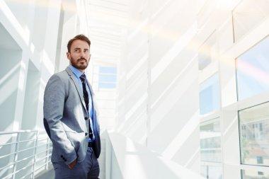 Businessman standing in modern interior