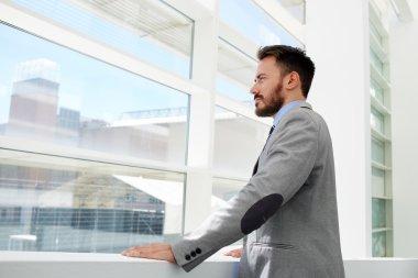 Businessman in formal wear looking in the window