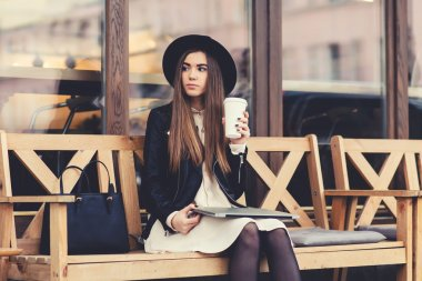 Trendy woman resting after work on net-book