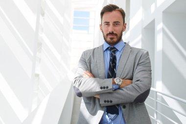Businessman in luxury suit posing in corridor