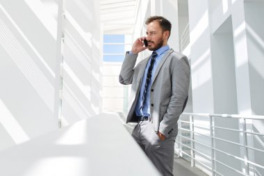 Businessman talking on mobile phone in office