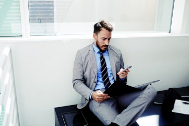 Businessman using cell telephone