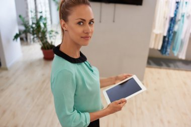 Woman with touch pad in fashionable store