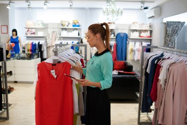 Beautiful business woman in fashionable store