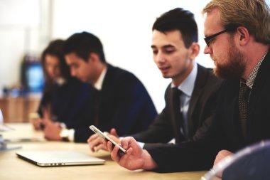 Business partners using smart phone