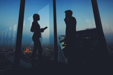 Silhouette of a two business partners