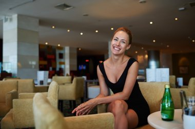 Businesswoman enjoying rest in cozy cafe