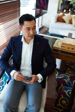 Businessman chatting on mobile phone