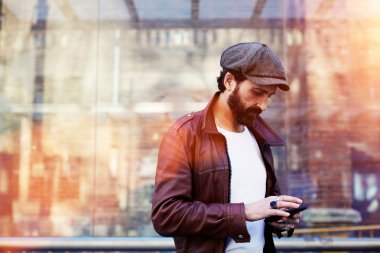 Man with mobile phone in urban setting